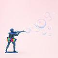 Toy Soldier Shooting Bubbles From Gun by Juj Winn