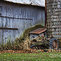 Tractor And Barn On Cloudy Day by David Arment