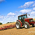 Tractor In Plowed Farm Field by Elena Elisseeva
