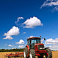 Tractor In Plowed Field by Elena Elisseeva