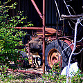 Tractor In Shed by Darrell Clakley
