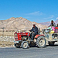Tractor Towing A Wagon Along The Road To Shigatse-tibet by Ruth Hager