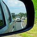 Trucks In Rear View Mirror by Renee Trenholm