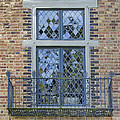 Tudor Style Windows With Balcony by Jit Lim