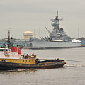 Tugboat Towing Past The Uss New Jersey by Berry Edwards
