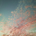 Turquoise And Peach Skies by Holly Martin