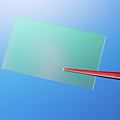 Tweezers Holding A Piece Of Optical Glass by Wladimir Bulgar/science Photo Library