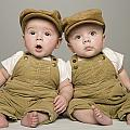 Two Babies In Matching Hat And Overalls by Kelly Redinger