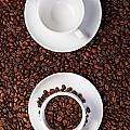 Two Cup With Coffee Beans by Raimond Klavins