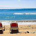 Two Empty Sun Loungers On Beach By Sea by Peter Noyce