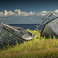Two Forlorn Abandoned Boats On Prince Edward Island by Randall Nyhof