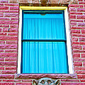 Two Gargoyle-like Figures Above And Below Window Of Moore Block In Pipestone-minnesota by Ruth Hager