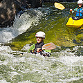 Two Kayakers On A Fast River by Les Palenik