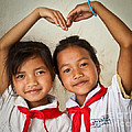 Two Lao Girls With Red Scarfs by Jo Ann Tomaselli