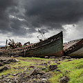 Two Large Boats Abandoned On The Shore by John Short