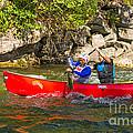 Two Men In A Tandem Canoe by Les Palenik