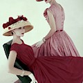 Two Models Wearing Red Dresses by Karen Radkai