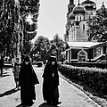 Two Nuns- Black And White - Novodevichy Convent - Russia by Madeline Ellis