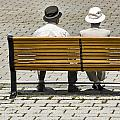 Two People Seated On A Bench by Randall Nyhof