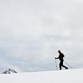 Two People Snow Shoeing Along A Ridge by Jordan Siemens