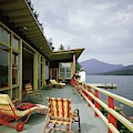 Two Women On The Deck Of A House On A Lake by Robert M. Damora