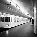 u-bahn train pulling in to ubahn station Berlin Germany by Joe Fox