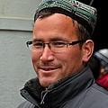 Uighur Man In Traditional Cap Smiles by Imran Ahmed