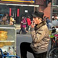 Uighur Street Side Bread Vendor Smokes Shanghai China by Imran Ahmed
