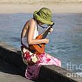 Ukulele Lady At Hanalei Bay by Catherine Sherman