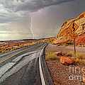 Uncertainty - Lightning Striking During A Storm In The Valley Of Fire State Park In Nevada. by Jamie Pham