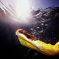 Underwater View Of Woman Swimming To by Thomas Barwick
