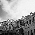 Upper Tiers Of The Old Roman Colloseum From The Inside Looking Up At Blue Cloudy Sky At El Jem Tunisia by Joe Fox