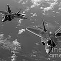 U.s. Air Force F-22 Raptors In Flight Near Guam. by Stocktrek Images