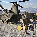 U.s. Army Sergeant Helps Unload Band by Stocktrek Images