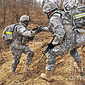 U.s. Army Soldiers Helps A Fellow by Stocktrek Images