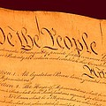 Us Constitution Closeup Red Brown Background by L Brown