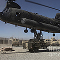 U.s. Soldiers Attach Sling Load Ropes by Stocktrek Images