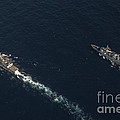 Uss Stockdale And The Canadian Frigate by Stocktrek Images
