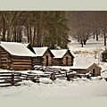 Valley Forge Cabins In Snow 2 by John Feiser
