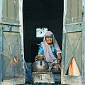 Varanasi Water Seller by Shaun Higson