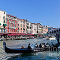Venice Italy Gondola With Tourists Floats On Grand Canal by Michal Bednarek