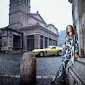 Veruschka Von Lehndorff Standing In Piazza Di San by Franco Rubartelli