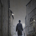 Victorian Man In Top Hat On A Cobbled Road At Night by Lee Avison