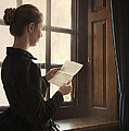 Victorian Or Edwardian Woman Reading A Letter By The Window by Lee Avison
