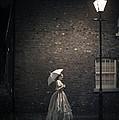 Victorian Woman Beneath A Street Lamp by Lee Avison