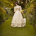 Victorian Woman In A Formal Garden by Lee Avison
