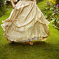 Victorian Woman Running On A Summer Lawn by Lee Avison