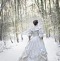 Victorian Woman Running Through A Winter Woodland With Fallen Sn by Lee Avison