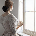 Victorian Woman With A Fan At The Window by Lee Avison