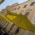 Vienna Street Life - Cheery Yellow Umbrellas At An Outdoor Cafe by Georgia Mizuleva
